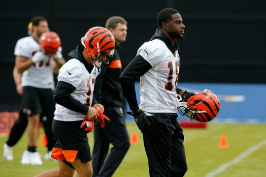 Cincinnati Bengals wide receiver A.J. Green (18) and the receivers break off into group drills during a practice at Allianz Park in London, on Friday, Oct. 25, 2019.