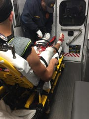 Finneytown quarterback Drew Finch is taken to the hospital after suffering a compound fracture in his left leg during the team's game against Mariemont on Oct. 11, 2019.