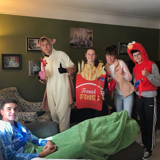 Finneytown National Honor Society officers visited Finch in his home after the injury to notify him of his induction into the organization.