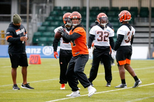 Cincinnati Bengals quarterback Andy Dalton (14) throws a pass during a practice at Allianz Park in London, on Friday, Oct. 25, 2019.
