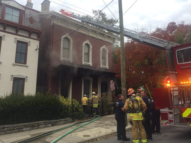 Covington and Cincinnati firefighters respond to a fire Oct. 25, 2019, at 106 E. 11th St., the home of Covington Mayor Joe Meyer.