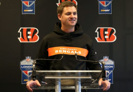 Cincinnati Bengals head coach Zac Taylor takes questions following practice, Friday, Oct. 25, 2019, at Allianz Park in London, England.