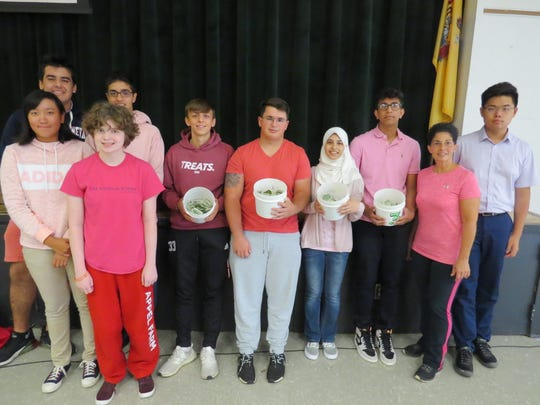Upper School students led the fundraising for Breast Cancer Awareness. (From left, back row) Shiv Tickoo of Scotch Plains, Aarush Dharayan of Edison, Ricardo Garces of North Brunswick, AJ Massaro of South Plainfield, Faizah Naqvi of South Plainfield, Shaan Jasti of Colonia; Dawn Francavilla, director of Student Life of Somerset, and Steven Li of Parlin. (Front row) Grace Lu of Edison and Abigail Newell of Livingston.