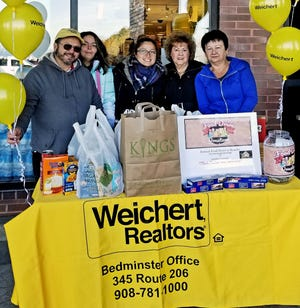 (From left) Weichert sales associate Harry Sandovnik and his daughters Stephane and Ratchell, along with Weichert sales associates Jean Jenkins and Luda Boltarets, helped collect donations to support the Food Bank Network of Somerset County.