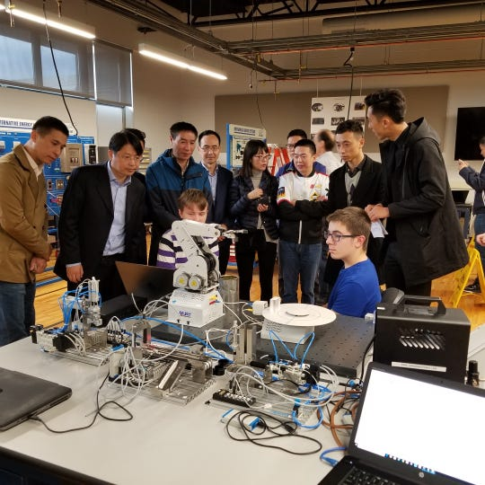 A delegation of industry representatives from China visit the pre-engineering and advanced manufacturing classroom on the MCVTS East Brunswick Campus.
