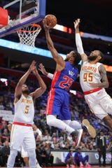 Detroit Pistons guard Derrick Rose shoots against Atlanta Hawks guard DeAndre' Bembry (95) during the second quarter Thursday, October 24, 2019 at Little Caesars Arena.