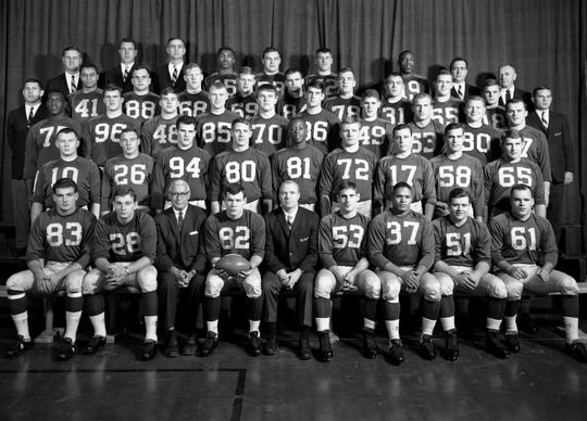 Tom Mack (96, in third row) and the 1964 Michigan football team.