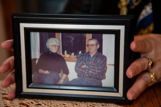 Margaret Rhead holds up a photo of her mom and dad. Her mother died of breast cancer. Rhead herself had 10 routine mammograms, but they came back inconclusive, and she wasn't willing to accept that result as meaning she was cancer free.