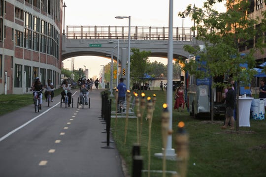 An evening garden party at Detroit's Dequindre Cut, an urban recreational path connecting Eastern Market to the Detroit River.