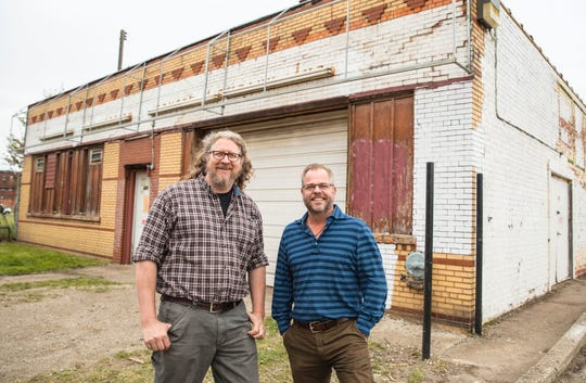 Founders Brewing Co. co-founders Dave Engbers, left, and Mike Stevens are pictured at 456 Charlotte Street in Detroit, where a brewery and taproom are planned to open in winter 2017.