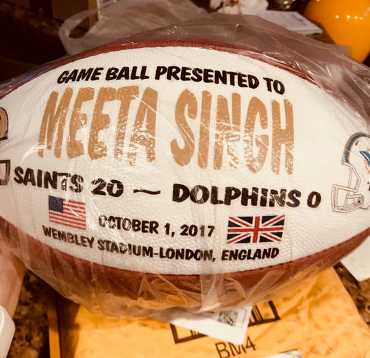 The New Orleans Saints presented this ball to Michigan sleep doctor Meeta Singh after beating the Miami Dolphins, 20-0, in London.