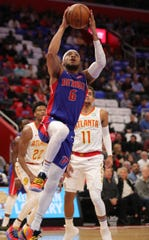 Detroit Pistons guard Bruce Brown (6) scores against Atlanta Hawks guard Trae Young (11) during first period action Thursday, October 24, 2019 at Little Caesars Arena in Detroit, Mich.