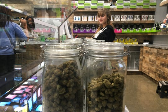 Budtender Elizabeth Clifford being the counter at House of Dank, a medical marijuana dispensary in Detroit in October, 2019.