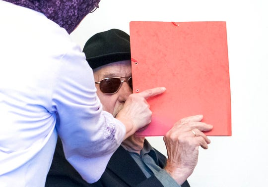 93-year-old former SS guard Bruno Dey in the concentration camp Stutthof near Danzig, arrives at the regional court in Hamburg, Germany, Monday, Oct. 21, 2019. The prosecution accuses the 93-year-old man of aiding and abetting the murder of 5230 people.