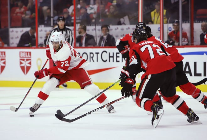 Detroit Red Wings center Andreas Athanasiou controls the puck during Wednesday night's loss to Ottawa.