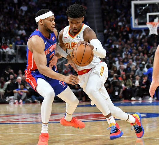 Pistons guard Bruce Brown, left, was limited to 17 minutes on Thursday due to foul trouble.