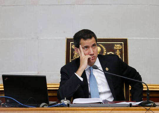 FILE - In this Oct. 1, 2019 file photo, Juan Guaido, opposition leader and self-proclaimed interim president of Venezuela, attends the weekly legislative session in Caracas, Venezuela.