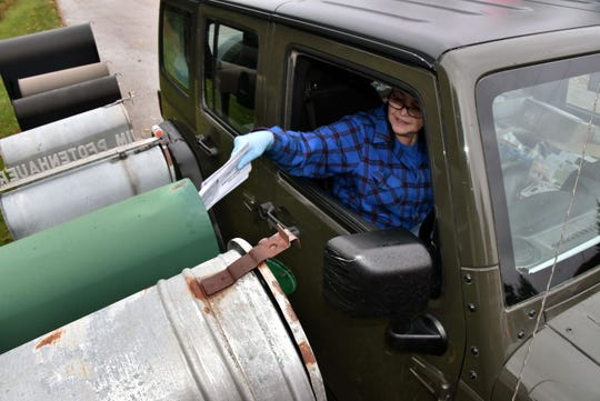 Susan Kleiman delivers mail along her 131-mile rural route, the longest in Michigan, which covers parts of Delta and Marquette counties.
