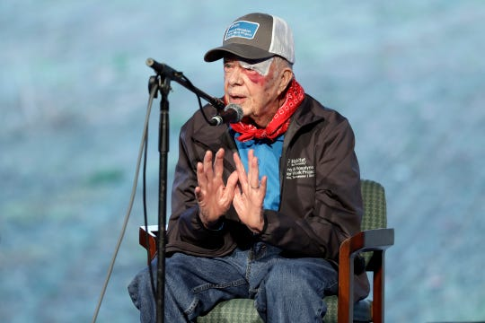 Former President Jimmy Carter leads a morning devotion for volunteers at a Habitat for Humanity building project Monday, Oct. 7, 2019, in Nashville, Tenn.