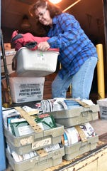 Susan Kleiman, 53, stacks boxes of sorted mail prior to embarking on her 131-mile rural delivery route.