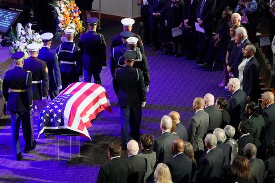 An honor guard stands next to the flag-draped casket of Rep. Elijah Cummings, D-Md., at the start of his funeral services at the New Psalmist Baptist Church in Baltimore, Md., on Friday, Oct. 25, 2019. At right are former President Barack Obama, Maya Rockeymoore Cummings, former President Bill Clinton, former first lady Hillary Clinton, House Speaker Nancy Pelosi, D-Calif., and former Vice President Joe Biden.