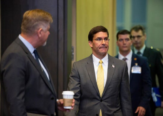 U.S. Secretary for Defense Mark Esper, center, arrives for a meeting of NATO defense ministers at NATO headquarters in Brussels on Friday.