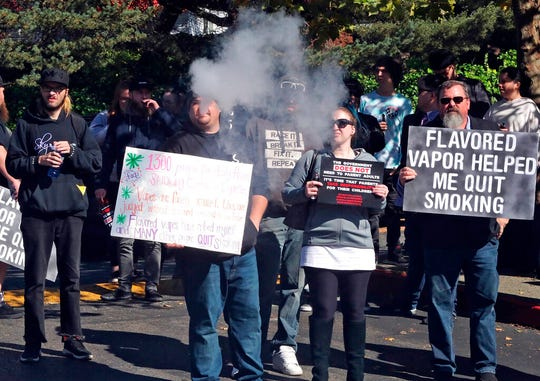 People who don't want flavored vaping products banned gathered to protest the Board of Health's planned vote to follow Washington Governor Jay Inslee's directive to the state Board of Health to use its emergency authority to ban all flavored vaping products, including those containing THC. The board's vote was unanimous, with one member abstaining.