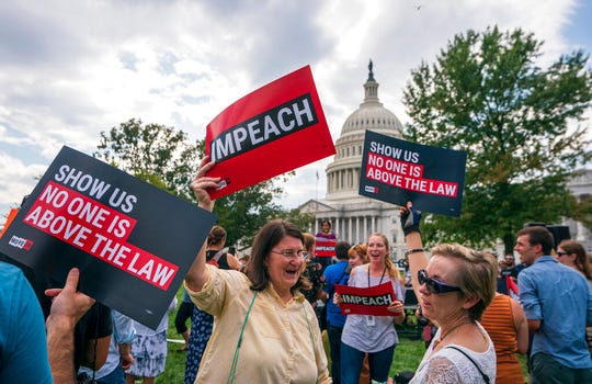 Activists rally for the impeachment of President Donald Trump, at the Capitol in Washington, Thursday, Sept. 26, 2019.