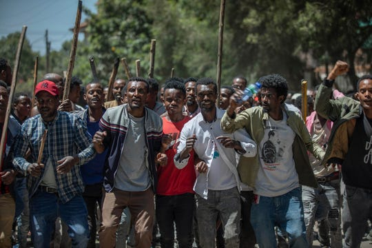 A group of supporters perform and shout slogans at the house of opposition leader Jawar Mohammed to show their support, in Addis Ababa, Ethiopia, Thursday Oct. 24, 2019.