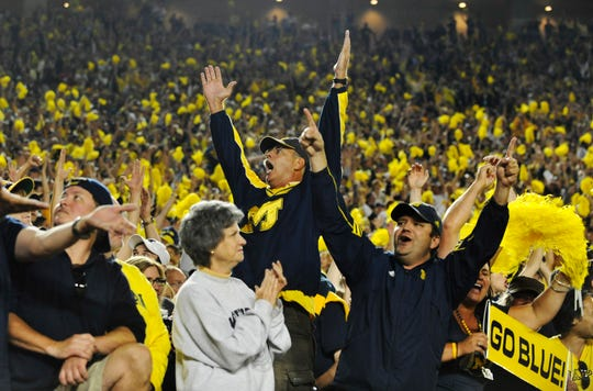 Michigan fans celebrate the win over Notre Dame in 2011.
