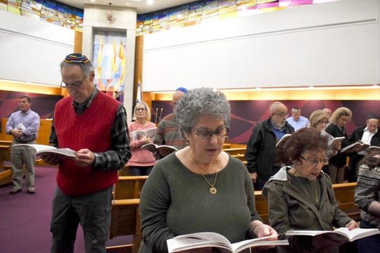 Worshippers attend Friday evening services at Adat Shalom in Farmington Hills on Friday. During the service, Rabbi Aaron Bergman referenced the one-year anniversary of the Tree of Life synagogue massacre in Pittsburgh, and talked of the importance of just showing up.