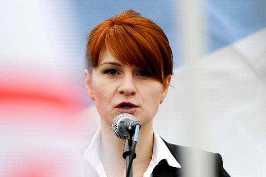 In this April 21, 2013 file photo, Maria Butina, leader of a pro-gun organization in Russia, speaks to a crowd during a rally in Moscow, Russia.
