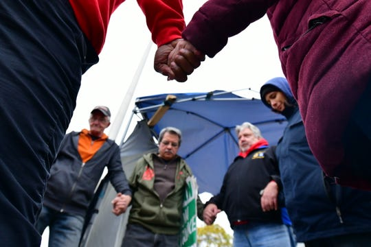 Group prayer to mark the end of the strike outside the Detroit-Hamtramck assembly plant in Detroit after the end of the strike in Detroit, Michigan on October 25, 2019.