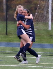 Rachel Simpson, left, and Ellie Mustico celebrate Mustico's goal in Elmira Notre Dame's 3-0 win over Trumansburg in a Section 4 Class C girls soccer quarterfinal Oct. 25, 2019 at Brewer Memorial Stadium.
