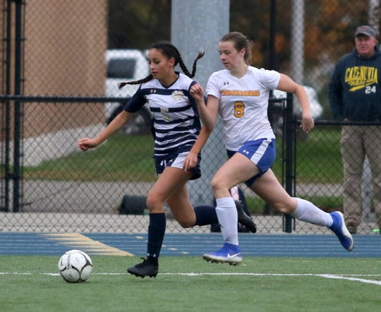 Leila Vargas of Elmira Notre Dame kicks the ball ahead as Trumansburg's Julia Wright gives chase during the Crusaders' 3-0 win in a Section 4 Class C girls soccer quarterfinal Oct. 25, 2019 at Brewer Memorial Stadium.