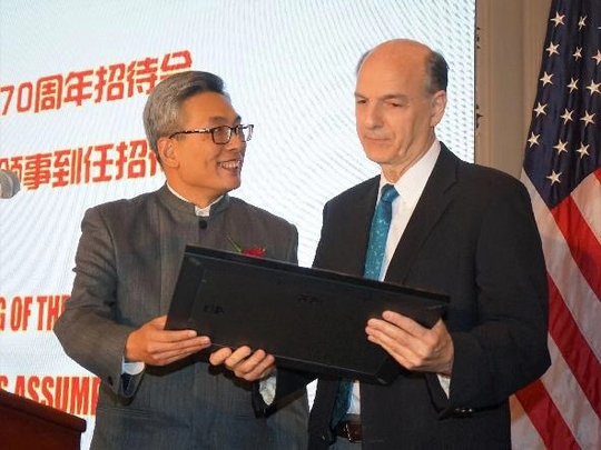 Dr. Robert Lodato (right) receives an award at the Chinese consulate in Houston, Texas, for his work in pulmonary medicine in China.