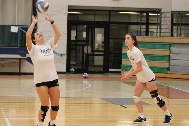 Terra State Community College volleyball player Cassie Hoover sets the ball for teammate Gail Swartzfager during an Oct. 18 practice at the college's Student Activities Center. The Titans were 10-10 entering their final week of play this season.