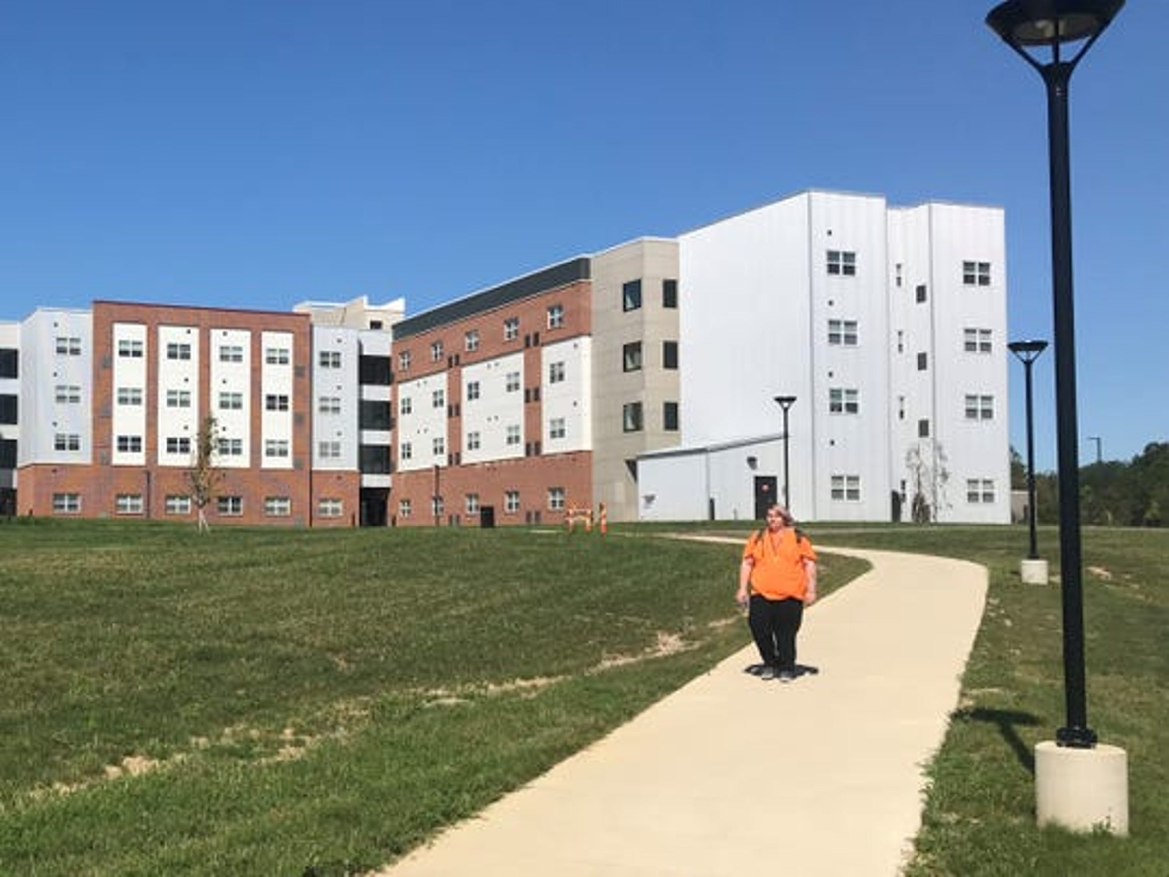 Andrew Nye, a hospitality major from Fostoria, walks from the Landings at Terra Village to a morning class at Terra State Community College. There are 157 people living in the student housing facility in the 2019 fall semester.