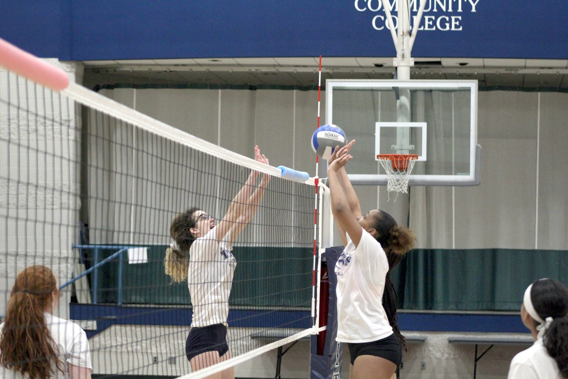 Terra State volleyball players battle at the net during an Oct. 18 practice. The team finishes its season Oct. 30 with a home match against University of Rio Grande JV.