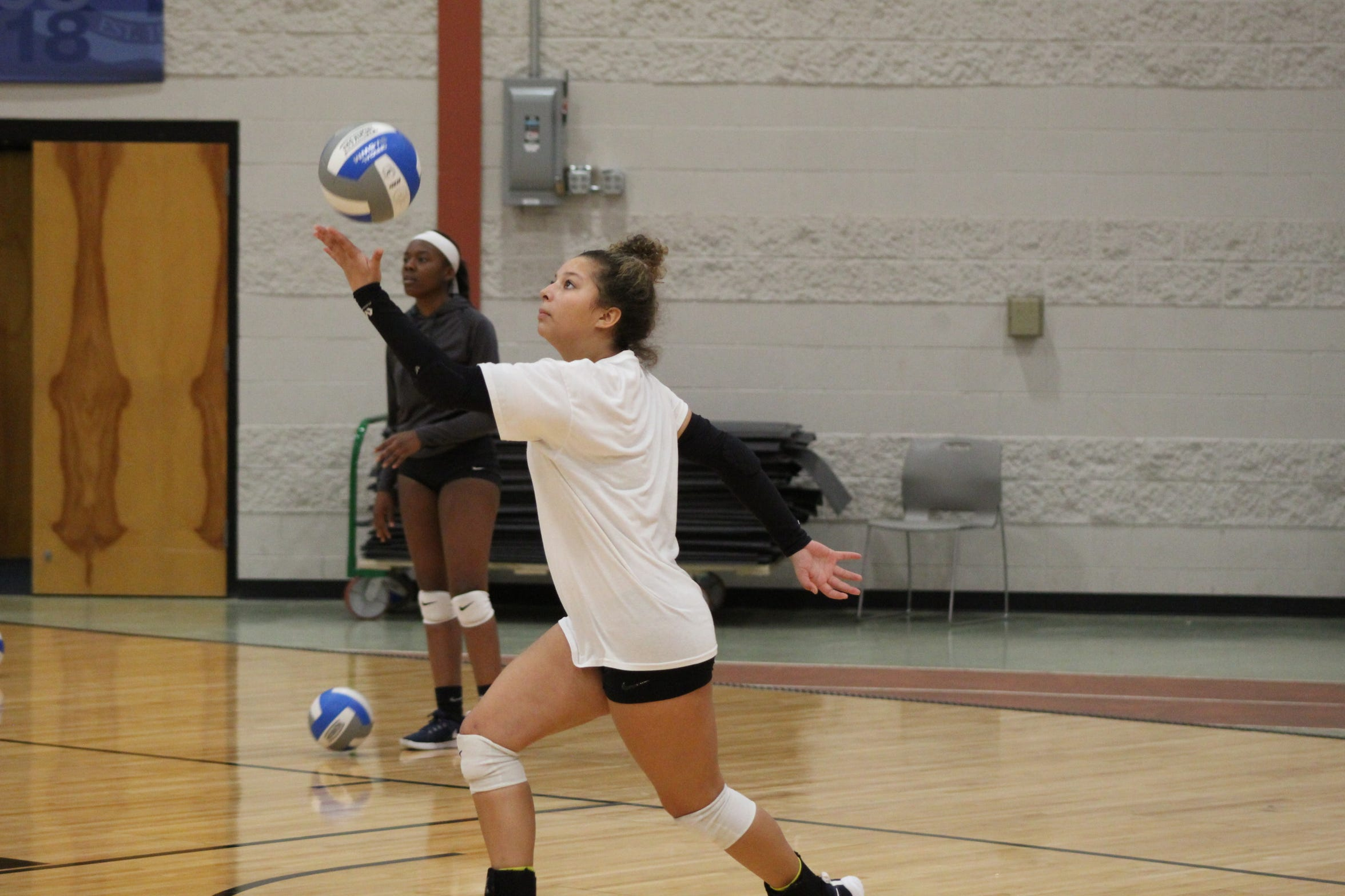 Terra State volleyball player Baleigh Robinson of Fostoria practices her serve during an Oct. 18 practice at the college's Student Activities Center.