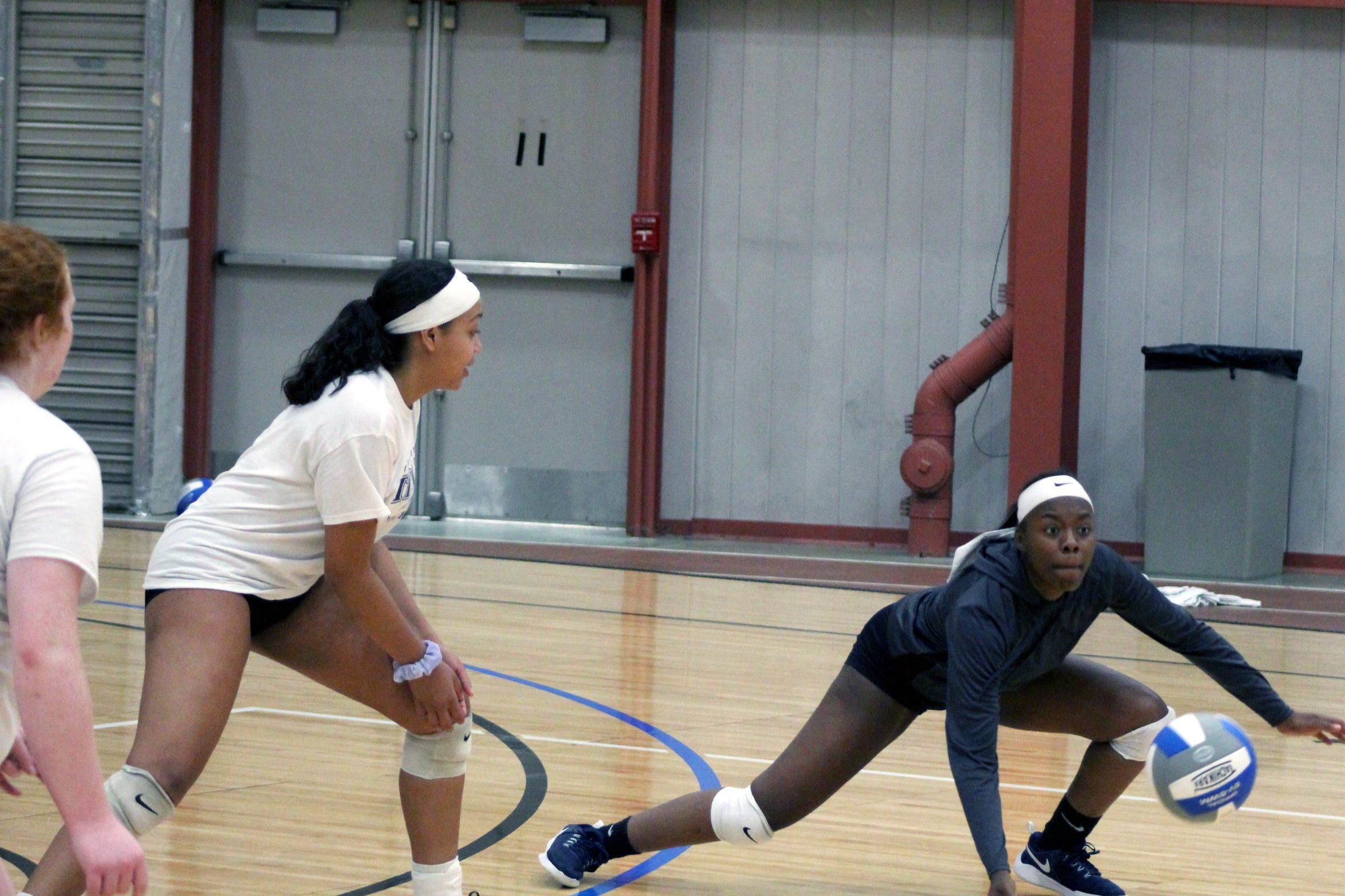 Terra State Community College volleyball players dive for a ball during practice Oct. 18.