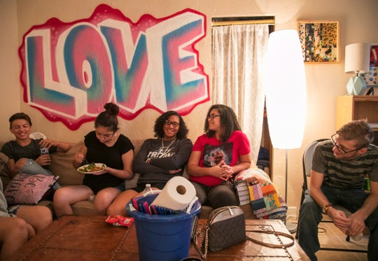 Teens check in with each other at Valerie's House during a support group meeting on Thursday, Oct. 24, 2019, in Fort Myers. The nonprofit organization, which helps children and their caregivers deal with the death of a parent or grandparent, is planning to construct a bigger building on a piece of land leased from the city of Fort Myers.