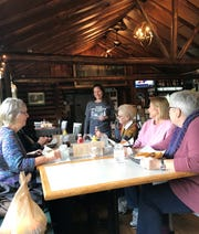 Co-owner Carolyn Ripp checks on lunch diners Donna Asher of Sturgeon Bay, Dorothy Berg of Sevastopol, Susan Deprez of Reedsville and Linda Monahan of Sturgeon Bay at The Hitching Post Bar & Grill in Valmy.