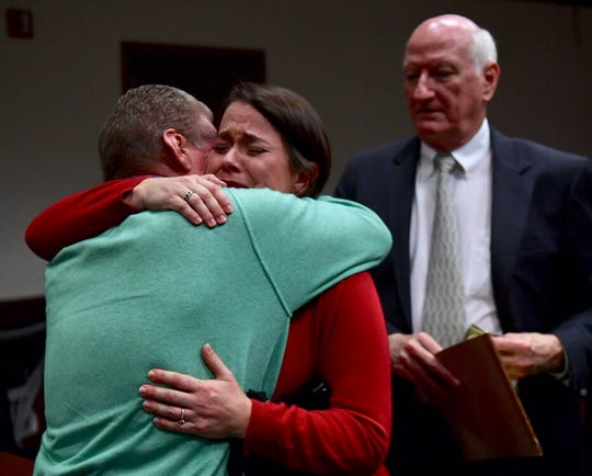 Convicted Sheriff Will Lewis' wife Amy cries and hugs family friend Thomas Heaney of Landrum after her husband is sentenced to 1 year in prison on day 5 of the misconduct trial, Oct. 25, 2019. He was convicted on one count of misconduct the day before.