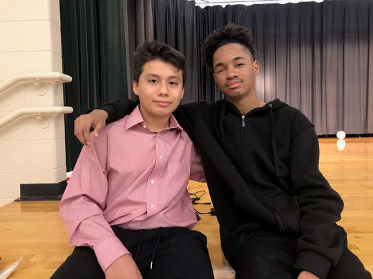 Luis Norberto, left, and Jayvontaye Savoy, right, pose at Tanglewood Middle School.