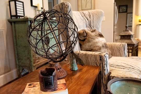 A decorative globe on table in Michael Cogdill's living room.