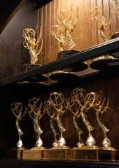 Michael Cogdill's Emmy Awards on a shelf in his living room.