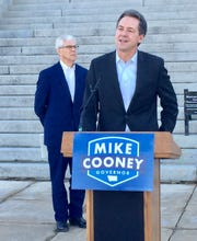 Gov. Steve Bullock, right, endorses Lt. Gov. Mike Cooney in the 2020 governor's race. The announcement was made Friday on the steps in front of the state Capitol.