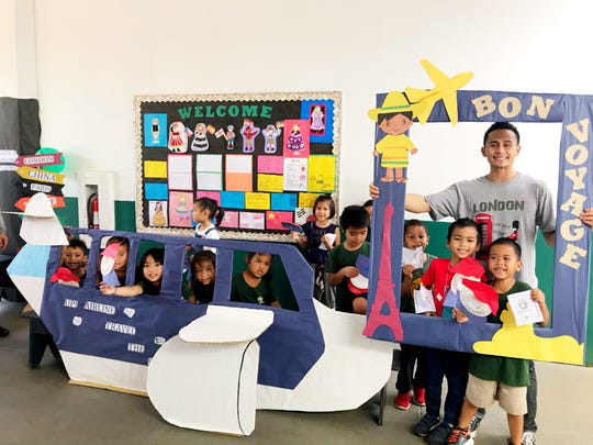 KinderBots posing with the 4th Grade Project displays for the Upi Elementary School United Nations Day Parade.