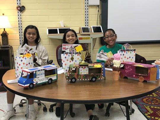Winners of the United Nations day small cardboard food truck competition. First place Christine Baluyut (Christine's Tapas Camion de Comida), second place Faith Manio (Dolci Delizie) and third place Khezzeah Crucena(Have a Bangkok Feast) under the Gate class of Raffy Manejero.
